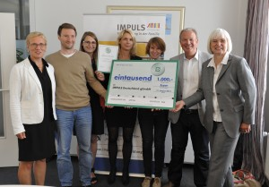 Prof. Dr. Eva Quante-Brandt, Peter Weber (IMPULS Deutschland gGmbH Geschäftsführer ) und Silke Janssen (Firma DEICHMANN) und Mitarbeiter der IMPULS Deutschland gGmbH